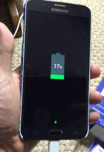 Picture of the Samsung Galaxy J7 Sky Pro smart phone, powered off and charging.