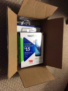 Picture of the Samsung Galaxy J7 Sky Pro Tracfone in open, original shipping box.