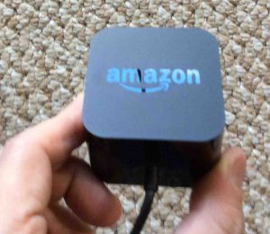 Picture of the Amazon Echo 2nd gen Alexa smart speaker power adapter, logo side view.