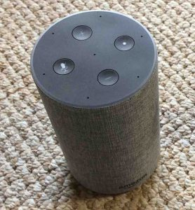 Picture of the Amazon Echo 2nd generation Alexa speaker, top view, showing the light ring and the volume, mic mute, and action buttons.