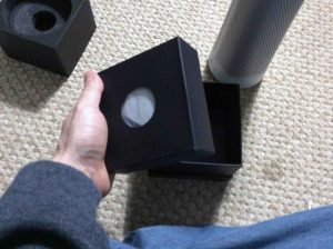 Picture of the Harman Kardon Invoke speaker inner accessories box, removed from outer box bottom.