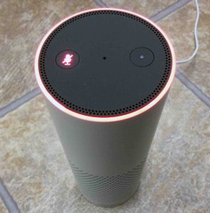 Picture of the Amazon Alexa Echo Gen 1 smart speaker, showing the Mic as off, mic mute on, as Indicated by the red light ring.