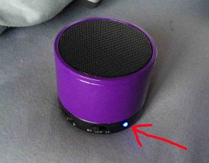Picture of the Craig Bluetooth speaker model CMA3568, front view, powered on and in Bluetooth pairing mode, with the blue pilot lamp highlighted.