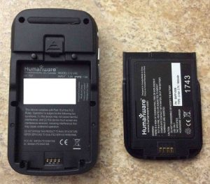 Picture of the Victor Reader Trek audio book player, back view, showing the rechargeable battery removed, along with writing on both battery, and inside the battery compartment.