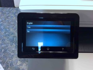 Picture of the HP Color MFP M477 printer, displaying its -English Language Confirmation- screen.