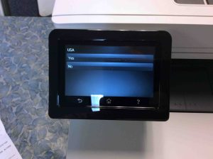 Picture of the HP LJ Pro M477 printer, displaying its -USA Location Confirmation- screen.