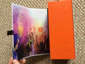 Picture of the JBL Flip 4 portable speaker, original box, opening outer flap. JBL Flip 4 portable Bluetooth speaker picture gallery.