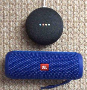 Picture of the JBL Flip 4 Bluetooth speaker with Google Home Mini smart speaker.