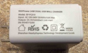How to charge JBL Flip 2 portable Bluetooth speakers. Picture of the RavPower 24W dual USB wall charger, showing its specs label side.