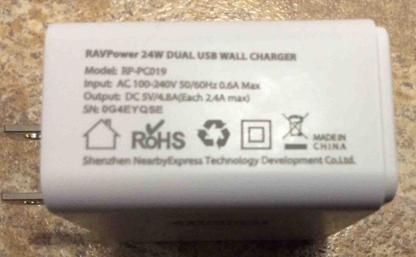 Picture of the RavPower 24W dual USB wall charger, showing its specs label side.