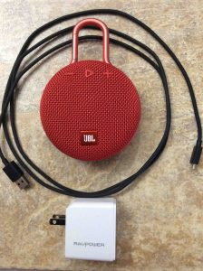 Picture of the JBL Clip 3 wireless Bluetooth speaker with RavPower USB charger and Amazon charge cord.