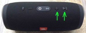 JBL Charge 3 reset instructions. Picture of the JBL Charge 3 IPX7 speaker, showing its Volume Up and Play Pause buttons highlighted.
