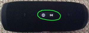 Picture of the JBL Charge 3 speaker and power bank during factory reset. Showing the glowing Power and Connect Plus buttons lighted and circled.