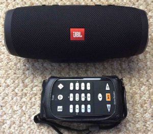 Picture of the JBL Charge 3 Bluetooth speaker with the Victor Reader Trek talking GPS media player, front view.