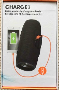 JBL Charge 3 waterproof wireless Bluetooth speaker picture gallery. Picture of the JBL Charge 3 wireless Bluetooth speaker, original packaging box, side 4. Showing connection to mobile phone for charging..