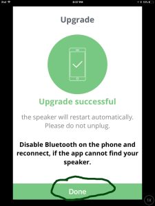 Screenshot of the JBL Connect Plus app on iOS, paired with a JBL Flip 3 Bluetooth speaker and power bank. The new firmware update to the speaker is successful. Done button highlighted. Updating firmware on JBL Flip 3 Bluetooth speaker.