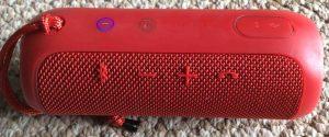 Picture of the JBL Flip 3 Bluetooth speaker, view of the buttons panel. JBL Flip 3 Bluetooth wireless speaker, red version, front view. Pairing JBL Flip 3 splashproof speaker with Victor Reader Trek.