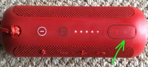 Picture of the JBL Flip 3 Bluetooth wireless speaker. Showing The USB AUX IN ports door closed and highlighted. How to Charge JBL Flip 3 splashproof Bluetooth speaker.
