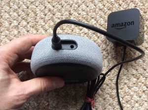 Picture of the Echo Dot 3rd Generation speaker AC power adapter, plugged into speaker back.