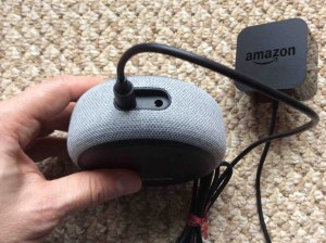 Picture of the Amazon Echo Dot gen 3 speaker AC power adapter, plugged into speaker back.