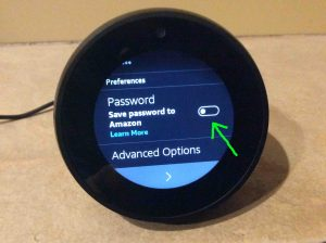 Picture of the talking speaker, showing its Save WiFi Password to Amazon screen, with that setting switch off. How to Set Up Alexa Echo Spot.