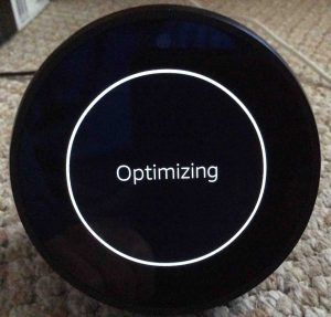 Picture of the Amazon Echo Spot speaker, finishing up optimization after factory reset.