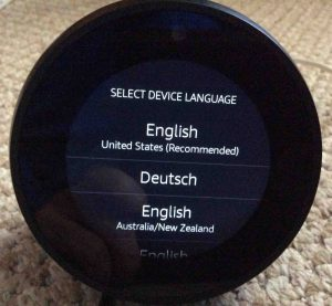Picture of the Amazon Echo Spot Alexa speaker, displaying its Select Device Language screen.