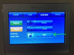 Picture of the t-stat, showing its -System Heat / Cool Mode Setting- screen, with the mode set to OFF.