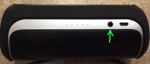 Picture of the JBL Flip 2 speaker, showing its AUX input port highlighted. JBL Flip 2 buttons.