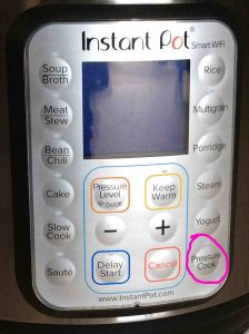 Picture of the Instant Pot WiFi electric smart cooker front view, showing the -Pressure Cook- button circled.
