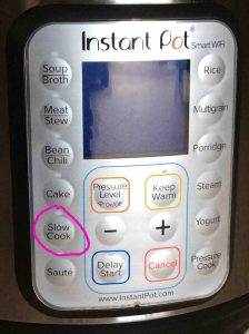 Picture of the Instant Pot pressure cooker smart WiFi front panel, showing the -Slow Cook- button circled.