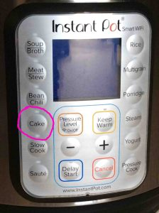 Picture of the Instant Pot WiFi electric pressure cooker control panel, showing the -Cake- button circled.