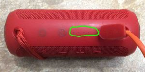 Picture of the speaker, connected to charger, now fully charged, showing all battery gauge lights OFF, and circled.