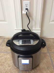 Picture of the Smart WiFi Instant Pot, plugged in and powered ON.