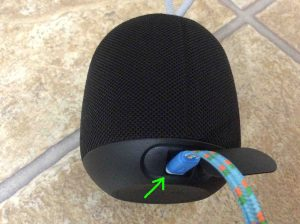 Picture of the Ultimate Ears Wonderboom Bluetooth speaker back view, with charging cord connected and highlighted.