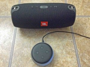 Picture of a JBL Xtreme speaker with an Alexa Echo Dot 3 smart speaker.
