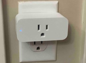 Picture of an Amazon Smart Plug, connected to AC power, and switched ON. Note the solid blue light at the left front of the unit.