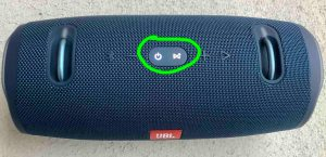 Top view of the JBL Xtreme 2 waterproof speaker, showing the -Power- and -Connect- buttons glowing during reset, dircled.