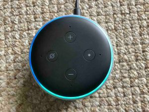 Top view picture of an Alexa Echo Dot speaker as it boots.