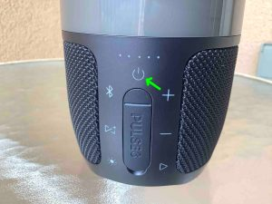 Picture of the Power button on the speaker back. JBL Pulse 3 Reset.
