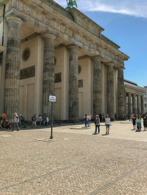 Brandenburg Gate and the line of the wall. The women are in what was East Berlin