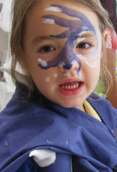 The child's costume was the influence for the face painting