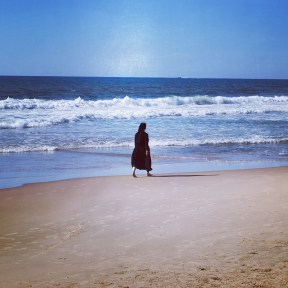 Nun Walking on the Beach of Tel Aviv
