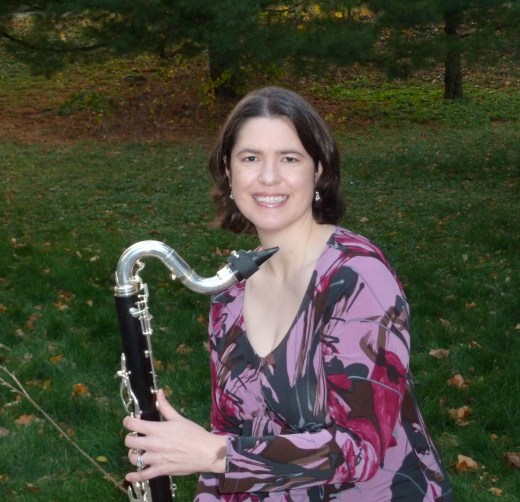 A photograph of Lori and her bass clarinet