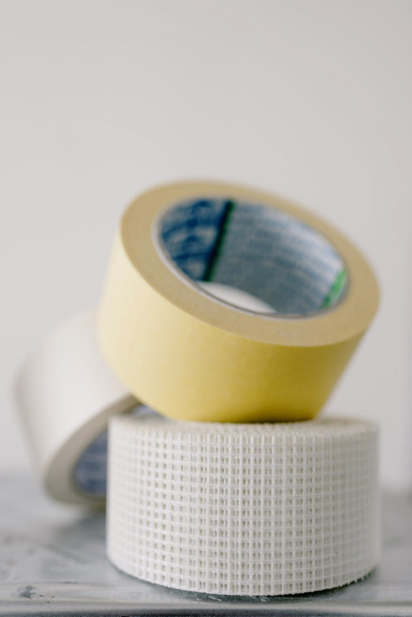 masking tapes on table against white wall
