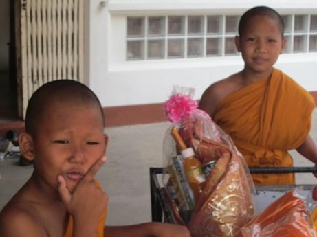 Baby monks cheesing