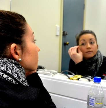 Madison applying makeup before the show