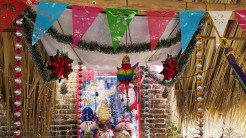 Altar at vendor stall at Puerto Ventanilla