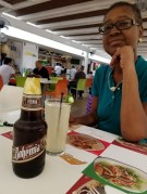 Toni eating and drinking at airport Huatulco