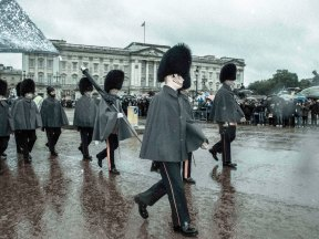 Changing of the guard on a rainy day